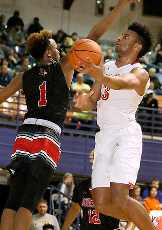 Brad Davis/The Register-Herald<br /> Oak Hill Academy's Braxton Key avoids Jonesboro defender Jamari Smith as he sails to the basket and scores Wednesday night at the Beckley-Raleigh County Convention Center.