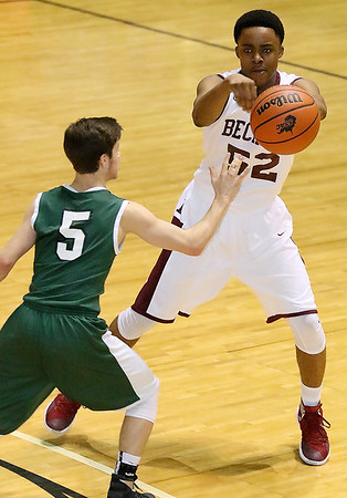 Woodrow Wilson's Breland Walton passes to an open teammate as Hampshire's Tyler Ault defends Friday night at the Beckley-Raleigh County Convention Center.