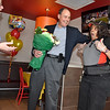 (Brad Davis/The Register-Herald) Harper Road McDonald's employee Sonia Smith reacts as she's informed by owners Myra (far left) and Tim (holding flowers) Harper, along with human resources consultant Janice Zvaleny (far right) that she's been named Crew Person of the Year for the company's Pittsburgh region during a suprise party Thursday afternoon.
