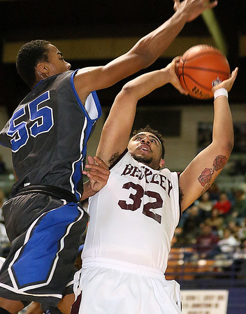 (Brad Davis/The Register-Herald)<br /> Woodrow Wilson's Tarek Payne is met by Capital defender Anthony Pittman as he tries to drive to the basket during the Flying Eagles' loss to the Cougars Wednesday night at the Beckley-Raleigh County Convention Center.