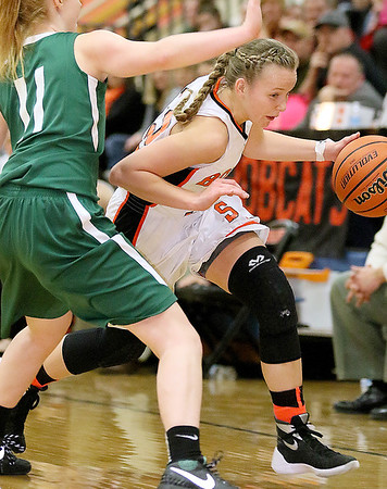 Summers County's Whittney Justice drives around Wyoming East's Megan Davis during the Lady Bobcats' win over the Lady Warriors Friday night in Hinton.