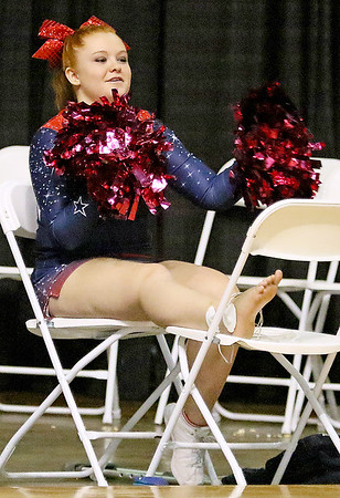 Brad Davis/The Register-Herald<br /> Independence cheerleader Tesa Danieley, injured during the previous night's game, joins her Patriot teammates during their game against Scott despite a sprained ankle Wednesday night at the Beckley-Raleigh County Convention Center.