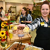 (Brad Davis/The Register-Herald) Dickey's Barbecue had a booth to remind people that they can do some great catering for any wedding or special occasion, and also to convince them with tasty sampler plates of food, as Lewisburg store manager Amanda Hall offers up during the Bridal, Prom and Special Occasions Fair Saturday afternoon at the Beckley-Raleigh County Convention Center.