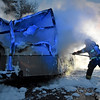 Smoke billows from a burned out utility trailer as a Beaver Volunteer firefighter tries to extinguish areas still burning Wednesday night along the Westbound lanes of Interstate 64 just past the Eisenhower Drive exit. The trailer belonged to FDH Velocitel, a company that builds and maintains broadcast and wireless towers, and was full of everything from electronic gear and antennas to winter clothing and climbing gear when it went up. The driver, Benjamin Ice, was hauling the trailer in a Ford pickup heading westbound towards the split with two other co-workers when he said another motorist drove up beside him and alerted them to the fire. The three then pulled off into the emergency lane, tried to use fire extinguishers they had in the truck, but the trailer was too fully engulfed for them to do any good.