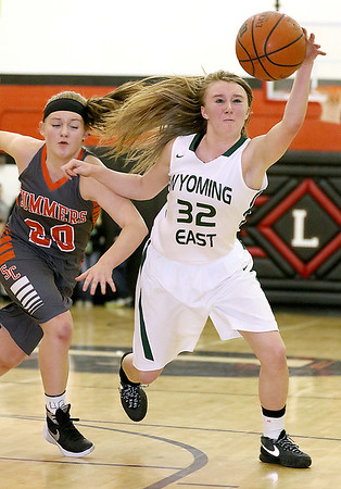 (Brad Davis/The Register-Herald) Wyoming East's Gabby Lupardus races to retrieve a loose ball during a sectional final game against Summers County at Liberty High School February 25 in Glen Daniel.