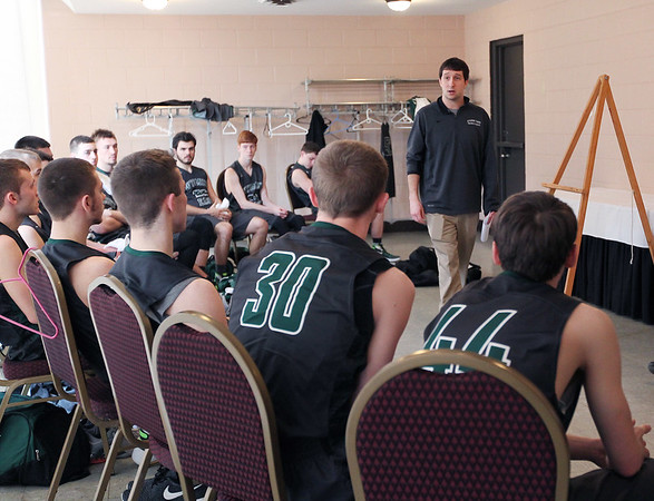 Wyoming East's head coach Rory Chapman talks with his team at half-time in their locker room during their  Class AA Boys Championship game against Robert C. Byrd at the Big Atlantic Classic Saturday in Beckley.