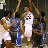 (Brad Davis/The Register-Herald)  <br /> Woodrow Wilson's Breland Walton leaps to throw a pass down court to teammate Nequan Carrington (foreground lower left) after he's cornered by a trio of Capital defenders during the Flying Eagles' loss to the Cougars Wednesday night at the Beckley-Raleigh County Convention Center.