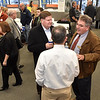Area business people, local leaders and friends chat and mingle as they enjoy the Beckley-Raleigh County Chamber of Commerce's monthly Business After Hours gathering at the recently opened Sleep Outfitters in the Plaza Mall Thursday night.