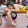 Greenbrier East's Jasiel Kinder takes on George Washington's Jack Lorea in the region three class AAA 120-pound weight class championship match Saturday afternoon at Woodrow Wilson High School. Kinder would go on to win the match.
