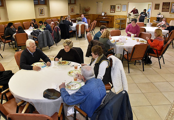 Church and community members enjoy an evening with friends and family during the first of St. Francis de Sales Catholic Church's annual six-week fish fry in observance of Lent Friday night.