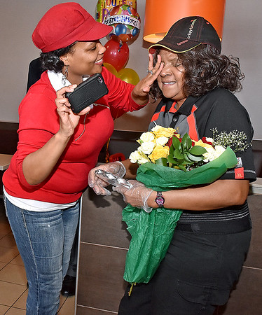 (Brad Davis/The Register-Herald) Harper Road McDonald's employee Sonia Smith's daughter Crystal Fogle helps wipe tears of joy from her eyes after being named Crew Person of the Year for the company's Pittsburgh region during a suprise party Thursday afternoon.