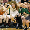 (Brad Davis/The Register-Herald) Wyoming East's Gabby Lupardus speeds around Summers County's Tiffani Cline Thursday night in Glen Daniel.