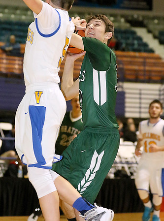 Brad Davis/The Register-Herald<br /> Fayetteville's Alex Hewitt drives and scores as Van's Daniel Gibson defends Monday night at the Beckley-Raleigh County Convention Center.