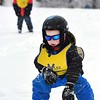 Zane Whitlater, 5, heads downs the slopes during the SkiWee program held at Winterplace Ski Resort Tuesday morning. This specialized instructional program provides the best learning environment for children to learn to ski and snowboard. SkiWee uses a group format dividing children by age and ability.  Group sizes range from 4-8 children per instructor. The program is appropriate for children ages 4-11 years of age.