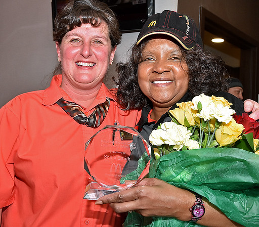 (Brad Davis/The Register-Herald) Harper Road McDonald's employee Sonia Smith, right, poses for a quick photo with general manager Angie Smith after receiveing her award for being named Crew Person of the Year in the company's Pittsburgh region during a suprise party Thursday afternoon.