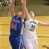 Brad Davis/The Register-Herald<br /> Morgantown's Courtney Quinn wins the battle for a rebound with Wyoming East's Haley Butcher Thursday night at the Beckley-Raleigh County Convention Center.