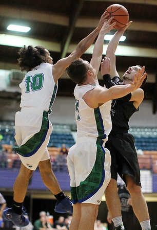 Robert C Byrd's Jemil North (10) blocks a shot attempt by Wyoming East's Logan Mullins (10) during their Class AA Boys Championship at the Big Atlantic Classic Saturday in Beckley.