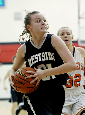 Westside's Brooke Russell (31) goes up for a layup during the second quarter of their sectional at Liberty in Glen Daniel on Tuesday. (Chris Jackson/The Register-Herald)