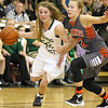 (Brad Davis/The Register-Herald) Wyoming East's Gabby Lupardus drives around Summers County's Whittney Justice Thursday night in Glen Daniel.