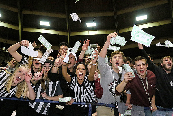 Woodrow Wilson students react after the clock ran out and the Flying Eagles claimed the class AAA championship Saturday night at the Beckley-Raleigh County Convention Center.