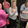 (Brad Davis/The Register-Herald) Bride-to-be Katelyn Bishop (middle), soon-to-be Lester, reacts as she discovers that she's the grand prize winner of a Tempur-Pedic Flex Elite queen-sized bed set from Grand Home Furnishings during this year's Bridal, Prom and Special Occasions Fair Saturday afternoon at the Beckley-Raleigh County Convention Center.