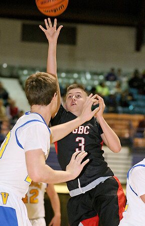 Greater Beckley Christian's Devin Acord tries to score against tough defense from Van's Cole Price defends during the class A championship game Saturday night at the Beckley-Raleigh County Convention Center.