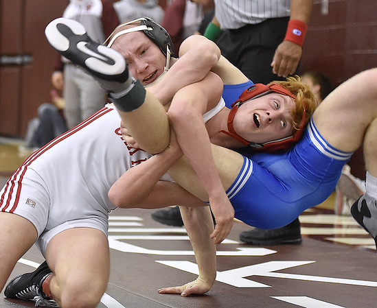 Oak Hill's Zach McCarthy flips Ripley's Andrejs Danilukes as he drives him out of bounds during the region three class AAA 126-pound weight class championship match Saturday afternoon at Woodrow Wilson High School. McCarthy would win the match and take the title.