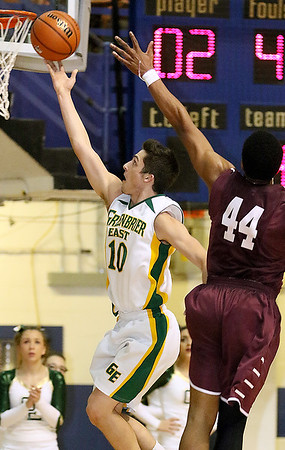 Greenbrier East's Caleb Ward scores during the class AAA championship game Saturday night at the Beckley-Raleigh County Convention Center.