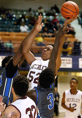 **Brad Davis/The Register-Herald** <br /> Woodrow Wilson's Breland Walton drives to the basket as Capital defenders Kerry Martin, right, and Neil Williams during the Flying Eagles' loss to the Cougars Wednesday night at the Beckley-Raleigh County Convention Center.