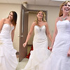 (Brad Davis/The Register-Herald) <br /> Bridal gown models (from left) Brigette Morris, Marty Walker-Owen and Jessica Poticher hang out backstage as they wait their turn to walk during the fashion show portion of the Bridal, Prom and Special Occasions Fair Saturday afternoon at the Beckley-Raleigh County Convention Center.