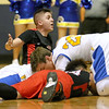Greater Beckley Christian's Devin Acord appeals for a call his teammates and Van players continue scrapping for a loose ball after the whistle during the class A championship game Saturday night at the Beckley-Raleigh County Convention Center.
