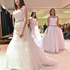 Bridal gown models (nearest to back) Brigette Morris, Jessica Potticher and Sarah Koontz walk from the stage area after showing off dress options during the Fit For a Queen Fashion Show portion of this year's Bridal, Prom and Special Occasions Fair Saturday afternoon at the Beckley-Raleigh County Convention Center.