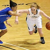 Brad Davis/The Register-Herald<br /> Wyoming East's Megan Davis drives around Morgantown's Aliyssa Neal Thursday night at the Beckley-Raleigh County Convention Center.