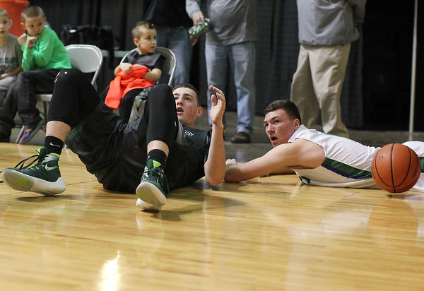 Wyoming East's Dylan Brehm (32) and Robert C. Byrd's Norman Junkins (4) wait for the call from the official during their Class AA Boys Championship at the Big Atlantic Classic Saturday in Beckley.