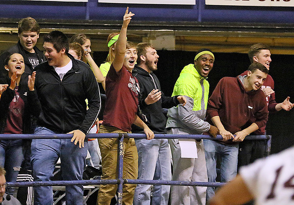 (Brad Davis/The Register-Herald)<br /> Woodrow Wilson students react after Flying Eagles player Nequan Carrington threw down a dunk on a breakaway during their game against the Capital Cougars Wednesday night at the Beckley-Raleigh County Convention Center.