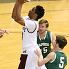 Woodrow Wilson's Malyk Fowlkes drives and scores past Hampshire defenders Tyler Andes (background) and Tyler Ault (#5) Friday night at the Beckley-Raleigh County Convention Center.