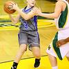 (Brad Davis/The Register-Herald) Princeton's Danielle Hall looks for an open teammate as she avoids Greenbrier East defender Katherine Walton Friday night in Fairlea.