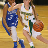 Brad Davis/The Register-Herald<br /> Greenbrier East's Kat Walton rushes up the court past Capital's Jana Faucett Thursday night at the Beckley-Raleigh County Convention Center.