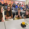 (Brad Davis/The Register-Herald) Park Middle School 8th grade teammates (from left) Lauryn Poole, Sierra Beaulieu, Roger Boone and Faith Shawver talk amongst themselves in search of an answer to their question as they compete in the History Bowl Saturday afternoon at Summers County Middle School.