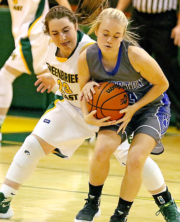 (Brad Davis/The Register-Herald) Greenbrier East's Lexi Tincher reaches in to try and steal the ball from Princeton's Danielle Hall Friday night in Fairlea.