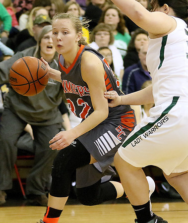 (Brad Davis/The Register-Herald) Summers County's Whittney Justice drives to the basket around Wyoming East's Haley Butcher Thursday night in Glen Daniel.