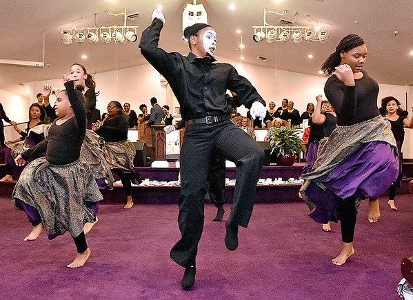 (Brad Davis/The Register-Herald) Jahovah's Praise, comprised of youth members of the church, performs a liturgical dance routine during a portion of Heart of God Ministries' Black History Month celebration Sunday evening at the Kanawha Street church.