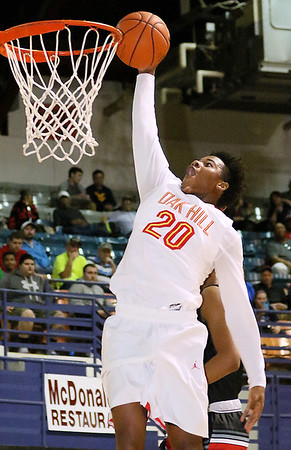 Brad Davis/The Register-Herald<br /> Oak Hill Academy's Devontae Shuler goes up for a dunk against Jonesboro Wednesday night at the Beckley-Raleigh County Convention Center.