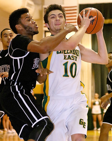 Greenbrier East's Caleb Ward tries to drive to the basket as Bluefield's Jaray Williams defends Friday night in Fairlea.