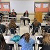 (Brad Davis/The Register-Herald) The scene inside one of the classrooms inside Summers County Middle School as scoreboard keeper and Summers County High School student Ben Neal runs the scoreboard while questioner Andrea Nelson with the West Virginia Division of Culture and History moderates during the History Bowl Saturday afternoon. Teams of four students from several area schools divided by grades sit in the front row while family, schoolmates and friends watch behind them.