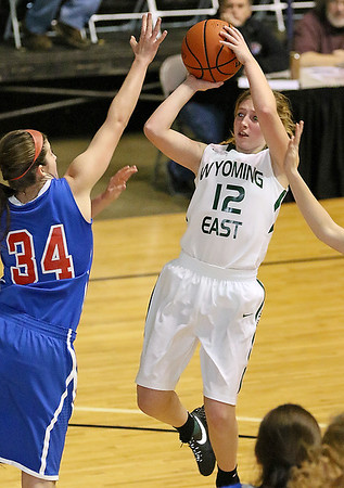 Brad Davis/The Register-Herald<br /> Wyoming East's Misa Quesenberry tries to drive to the basket against tough defense from Morgantown's Courtney Quinn Thursday night at the Beckley-Raleigh County Convention Center.