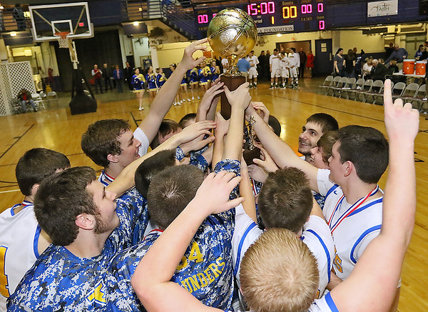 The Van Bulldogs celebrate a class A championship victory over Greater Beckley Christian in the Big Atlantic Classic Saturday.