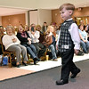 Three-year-old Nathan Settle gets a great reaction from the crowd as he models formal attire during the fashion show portion of the Bridal, Prom and Special Occasions Fair Saturday afternoon at the Beckley-Raleigh County Convention Center.