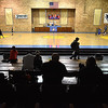 Parents and guardians watch from the theater seating inside the Mount Hope Community Center Thursday night as youth basketball league teams from the Kindergarten and first through second grade divisions practice.
