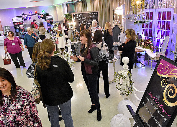 (Brad Davis/The Register-Herald) Brides-to-be and their accompanying family browse the vendor area to get ideas and arrange services for their upcoming weddings during the Bridal, Prom and Special Occasions Fair Saturday afternoon at the Beckley-Raleigh County Convention Center.